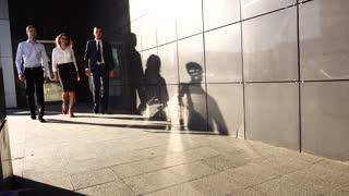 Business Team Walking With Shadows Light Near Center Office