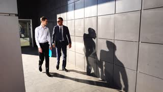 Business Team Walking With Shadows Near Center Office
