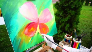 Colorful Oil Painting of Butterfly Drawn by Artist Girl in Park Outdoors.