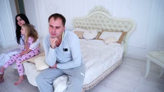 Couple Quarrel and Child Upset, Sitting Bed in White Interior