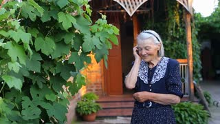 Elderly older female talking on phone