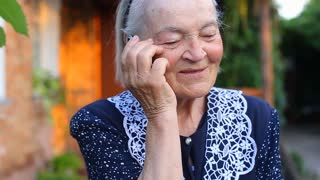 Elderly older female woman talking on phone smilling