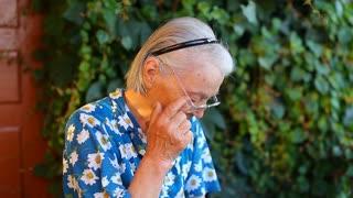 Elderly older woman tears
