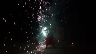 Fire Show Artist Breathe Fire in the Dark Performance Presentation in Action in Night Time. Flaming Trails, Amazing