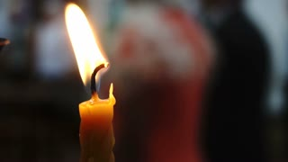 Hot Flames of Candle Isolated in Black Background Dark Room