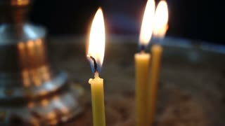 Hot Flames of Three Candles Isolated in Black Background Dark Room