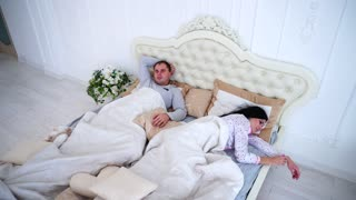 Man Can Not Sleep in Bed, Thinking While Wife Sleep
