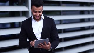 Man in Suit Arabic With Tablet Near Business Point Finger to Tablet