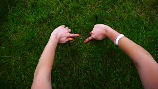 Shooting Close-Up of Girl Hands, Which Leads Female Across Grass and Draws Heart.