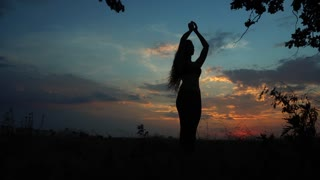 Silhouette Female Girl is Doing Yoga Background Red Sunset Sky