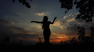Silhouette of Female Girl Yoga on the Background of the Sunset Sky Pose