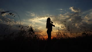 Silhouette of One Girl Yoga Dancing Background of the Sunset Sky