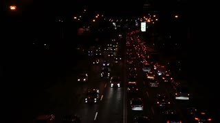 Time Lapse Cars Going Fast on the Streets. Lights Brighten the City at Night, View From Bridge