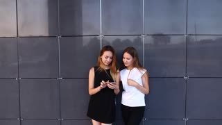 Two Student Female Friends Laught Look at Phone