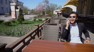 Arabian guy talking with friend by phone