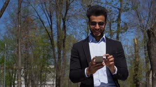 Arabian writer checking e-mail on phone in slow motion
