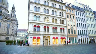 Beauty of old European city Dresden. video shows ancient majestic cathedrals, strict and beautiful houses and buildings in multi-colored pastel colors, streets with gray stone blocks and restaurants