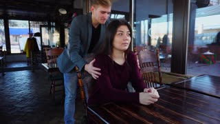 Brother surprising sister by unexpected appearance in luncheonette