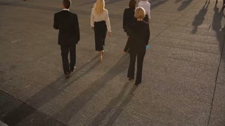 Business persons walking outside in slow motion