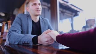 Close up holding hands and conversation of romantic couple
