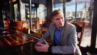 Employer waiting for person before job interview at cafe