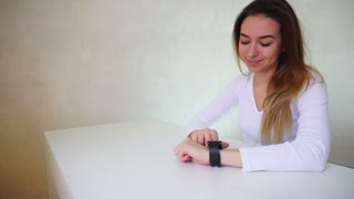 Fair-haired girl chatting using smart watch