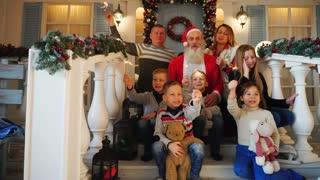 Family having many children celebrating Noel with Father Christmas