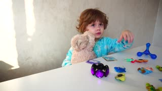 French little girl tired in kitchen on sunny day