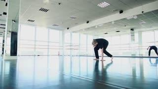 Guy making break dance movements in slow motion