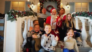 Happy big family celebrating Christmas with Santa Claus