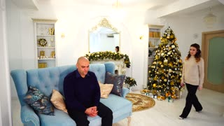 Head of family, man needs support and love of happy big family, being in decorated in New Year's living room with festive Christmas tree