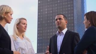 Male boss talking with business employees in La Defense Paris