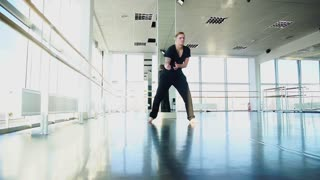 Male person dancing in street style way and jumping in slow motion