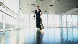 Man dancing and making swipes at studio in slow motion