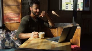 man looking for funny videos in internet on laptop