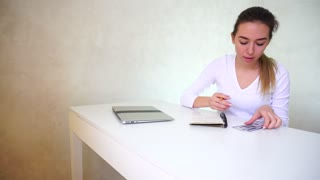 Mother planning expenses of family