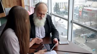 Retired Old Man Asks For Advice About New Technology Tablet at Beautiful Young Worker Social Services