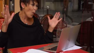 Slow motion aged sister have conversation with relative by laptop
