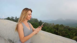 Slow motion fashion designer young woman holding tablet, lady in foreign country for business trip. Concept of innovative technologies or travelling, international cooperation. Pretty woman in grey