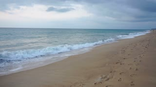Slow motion realtor making video at seaside, person preparing advertisement about plots of land for sale. Concept of real estate services, travelling and tourism. Camera capturing sea waves rolling on