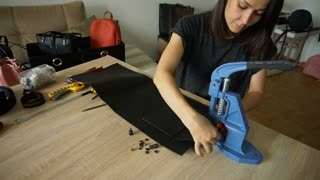 Slow motion young designer making women bags for sale
