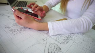 Student scans social network using smartphone during homework