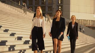 Successful business team walking on stairs in slow motion
