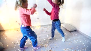 Two kids dancing at home christmas party