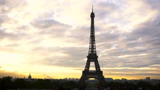 Violet clouds and Paris landscape. Eiffel Tower on sunset sky background. Concept of France attractions.