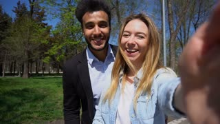 Young couple talking with psychologist by video call in slow motion