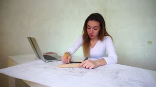 Young scientist sitting near table at home and working, girl found mistakes and understood all work should be redone