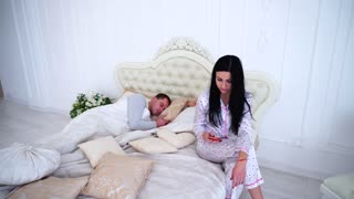 Wife Checks Meanly Her Husband's Phone, While he Sleeps