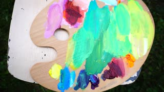 Wooden Palette With With Blurred Colored Oil Paints.