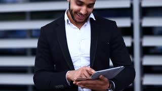 Young arabic man uses tablet  online order shopping in business center